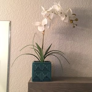 Faux white orchid in blue pot